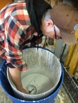 Me putting ceramic shell on mold.